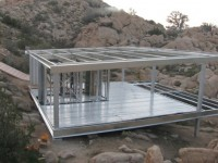 A Steel Prefab Treads Lightly on a Desert Floor