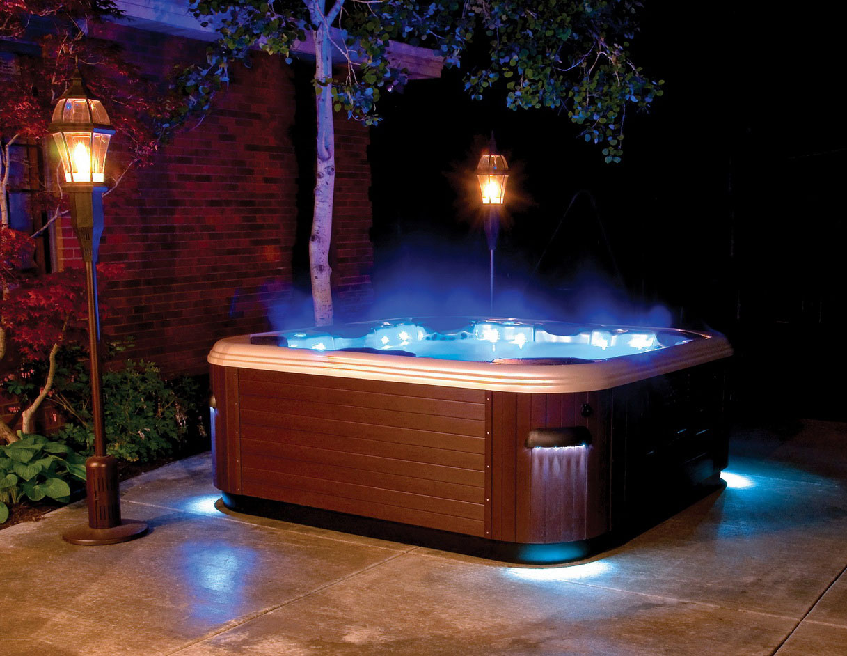 popular ways to enhance the look of a hot tub unite for climate. Black Bedroom Furniture Sets. Home Design Ideas