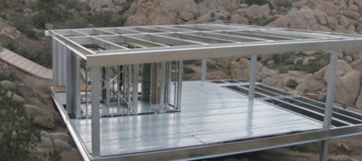 A Steel Prefab Treads Lightly on a Desert Floor